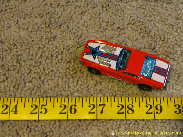 Launching Cars Measuring Practice - an easy to set up, quick play idea that practices number recognition and measuring skills.