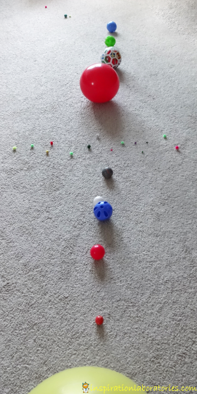 Practice placing the planets in order using balls.