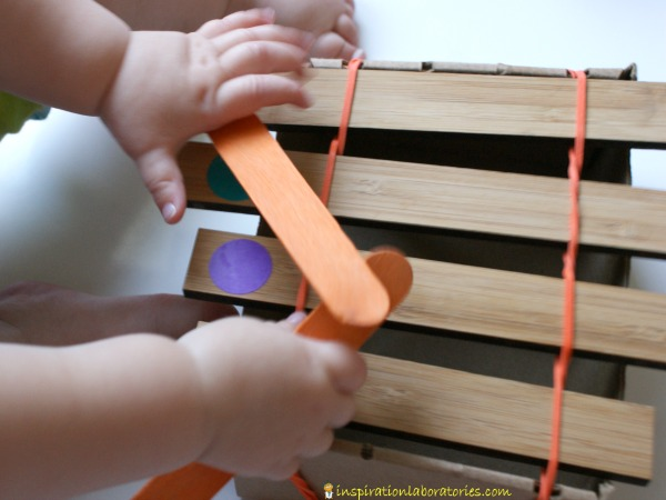 toddler exploring xylophone