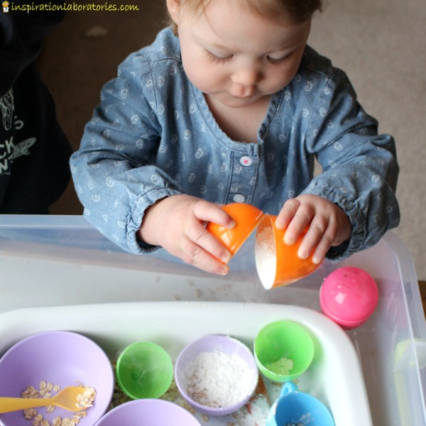 Set up a sensory bin with plastic Easter eggs.