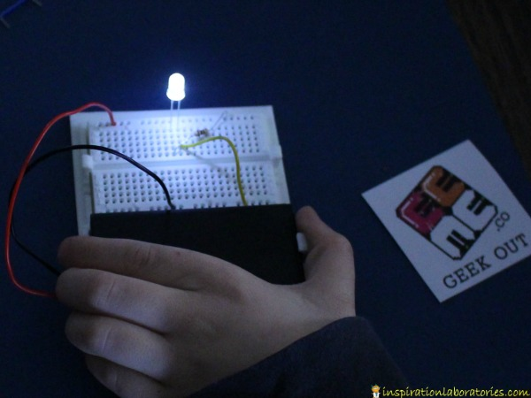 Make a simple LED circuit with a breadboard.