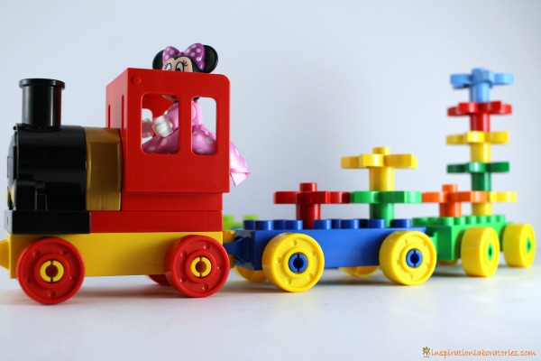 Practice counting flowers with a DUPLO train.
