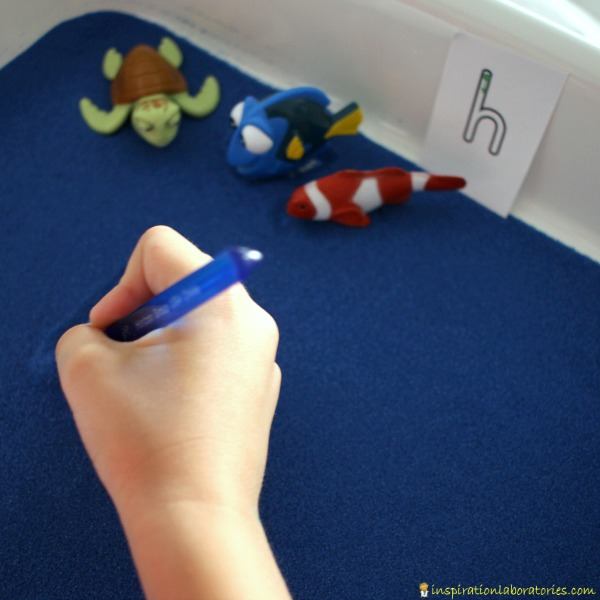 Use a Finding Dory Sensory Writing Tray to practice lowercase letter formation.