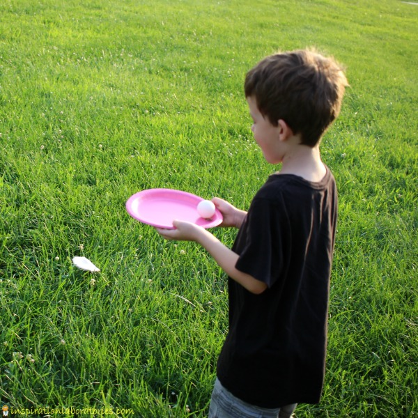 Create a golf ball carry game with paper plates.