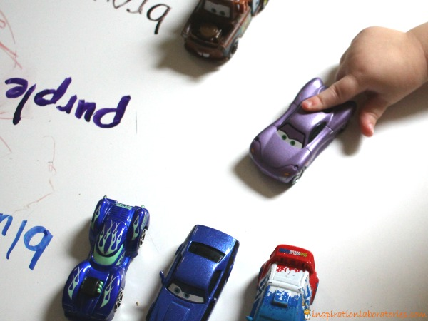 Use toy cars to learn colors.