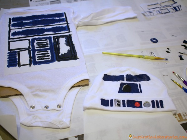 Use a freezer paper stencil to make an R2-D2 costume for baby.