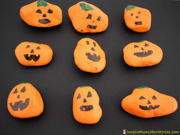 Use painted pumpkin rocks for a fun alphabet matching game.