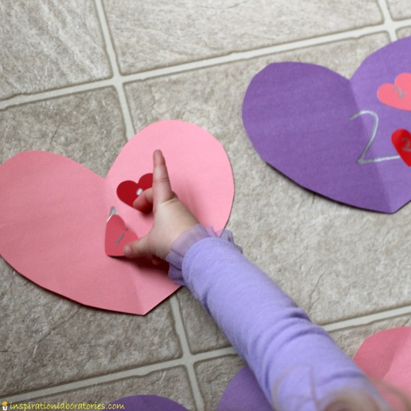 Practice number recognition and counting with a valentine hearts number line matching game.
