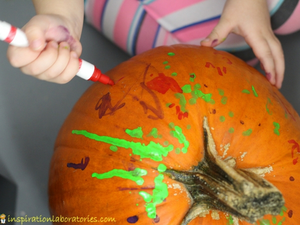 Use chalk markers for a simple pumpkin pre-writing activity inspired by Five Little Pumpkins.