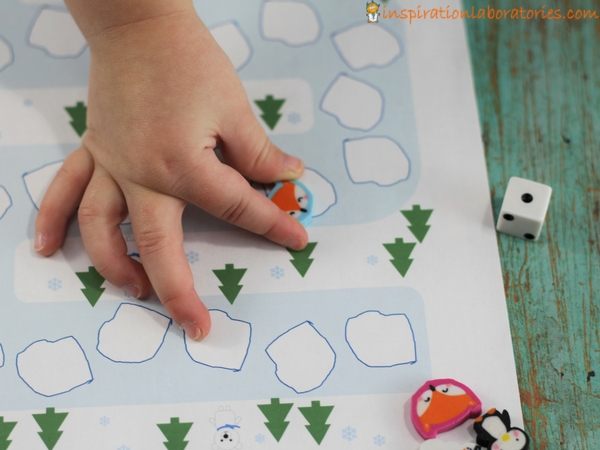 Play a preschool math game with a free printable winter math game board.