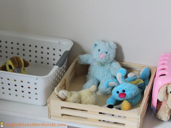 stuffed animals on a shelf for pretend pet store
