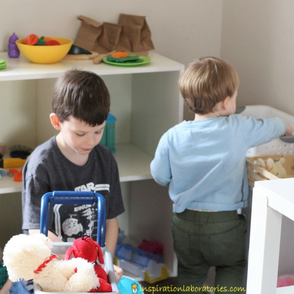 two kids shopping in pretend pet store