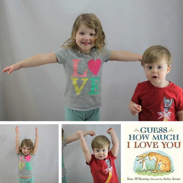 Kids stretching arms with Guess How Much I Love You book
