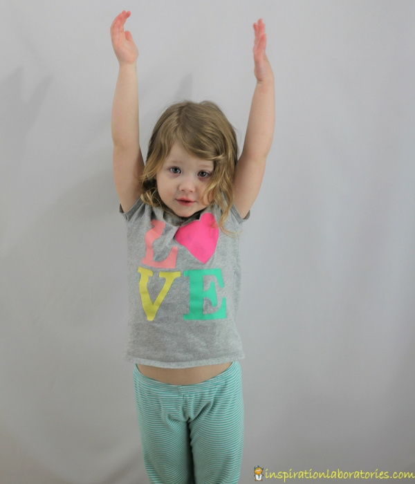 girl reaching arms up