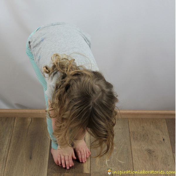 girl touching her toes