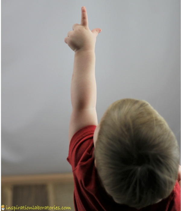 boy pointing up