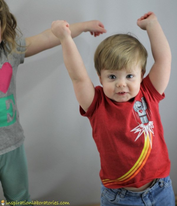 boy reaching arms up