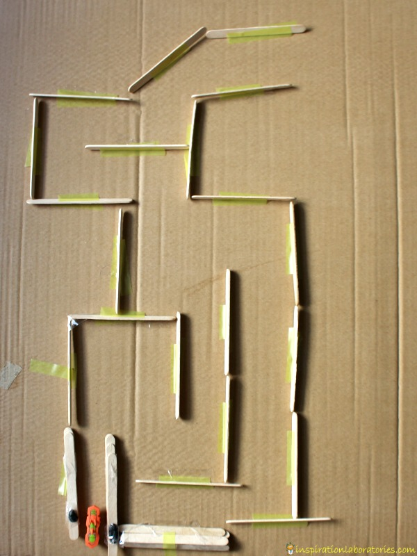 Challenge your kids to build a hexbug maze with craft sticks