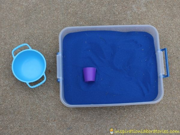 Dragon Treasure Sensory Bin - set up a simple sensory bin with colored sand, treasures, and dragons.